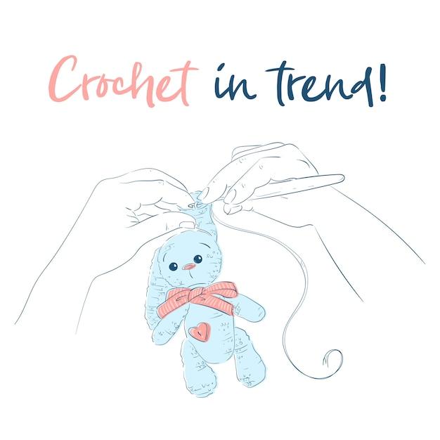 Hands with a crochet hook bunny. Premium Vector