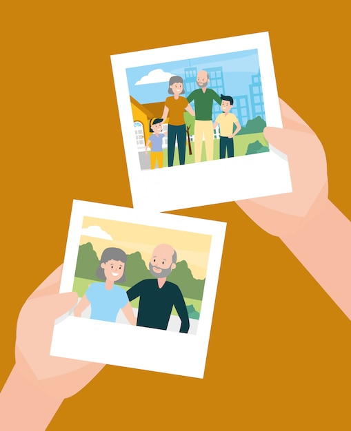 Hands with photos in familiy day Free Vector