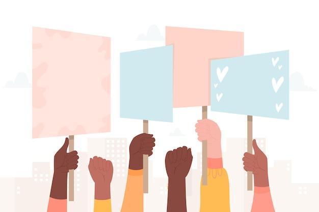Руки с плакатами толпы протестующих Бесплатные векторы
