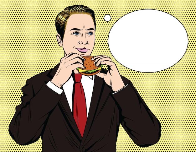 Красивый счастливый парень в костюме ест гамбургер Premium векторы
