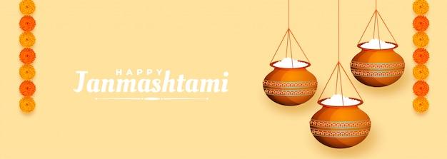 Banner dahi handi makkhan da appendere per il festival janmashtami Vettore gratuito