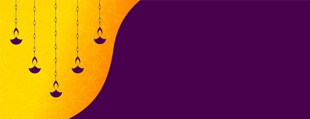 Hanging diya decoration diwali festival banner design Free Vector