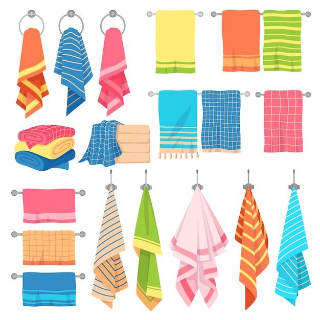 Вывешивание полотенец. повесить ткань мягкого цвета свежий текстиль кухонный или изолированный набор банных полотенец с клетчатыми чистыми сложенными элементами Premium векторы