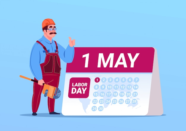 Happy 1 may labor day with builder or engineer over calendar Premium Vector