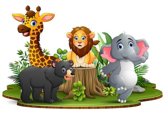 Happy animals cartoon in the park with green plants Premium Vector