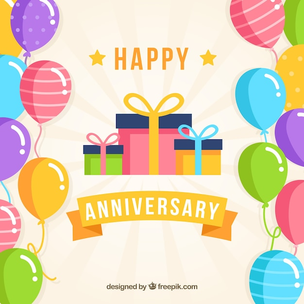 Happy anniversary background with balloons and gifts box Free Vector