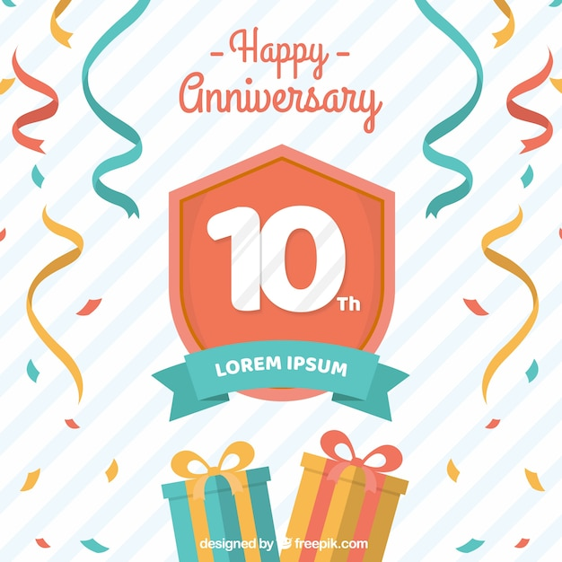 Happy anniversary card with gifts box and confetti Free Vector