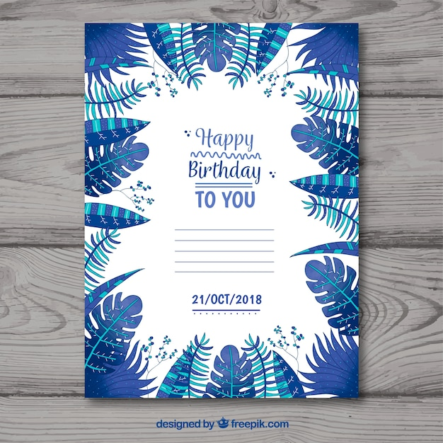 Happy birthday card with blue leaves in flat style Free Vector