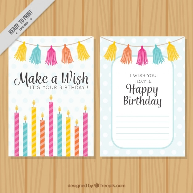 Happy birthday card with colorful candles and garlands Premium Vector
