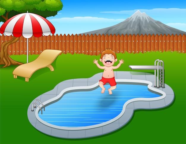 Happy boy cartoon jumping in swimming pool Premium Vector