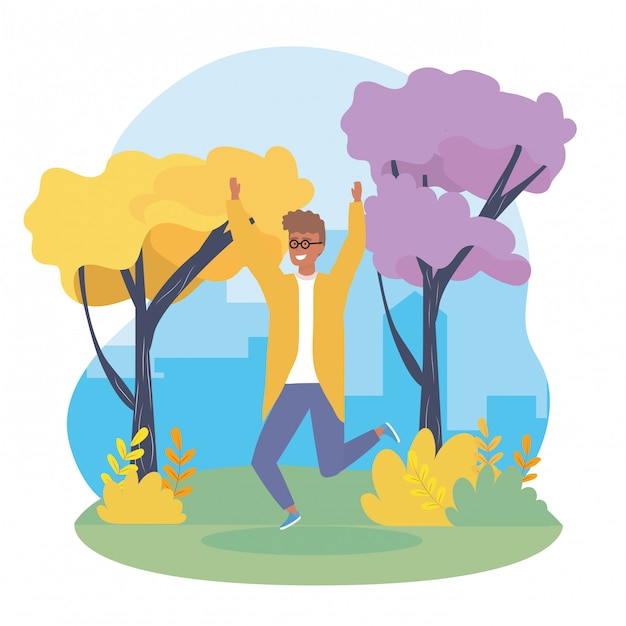Happy boy jumping with casual clothes and trees Free Vector