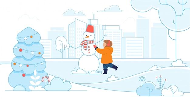 Happy child making a snowman Premium Vector
