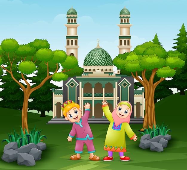 Happy children are posing in front of the mosque Premium Vector