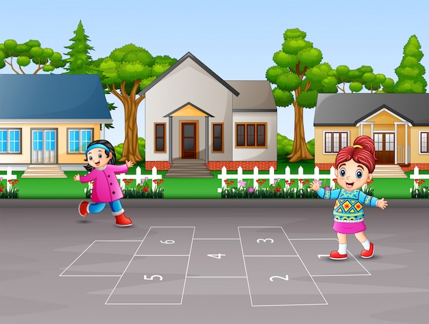Happy children playing hopscotch in the yard Premium Vector
