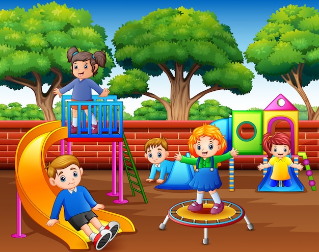 Happy children playing in the playground at daytime Premium Vector