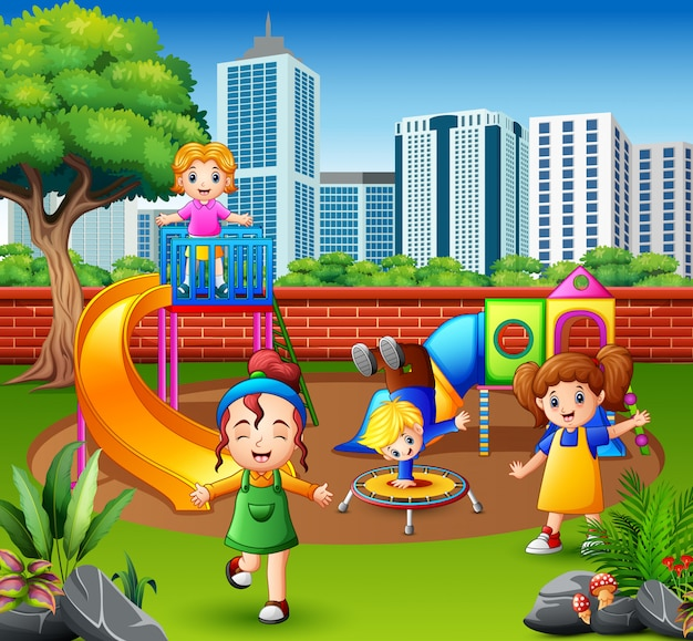 Happy children playing in the playground Premium Vector