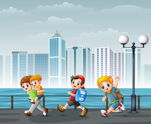 Happy children playing at the riverbank across the cities Premium Vector