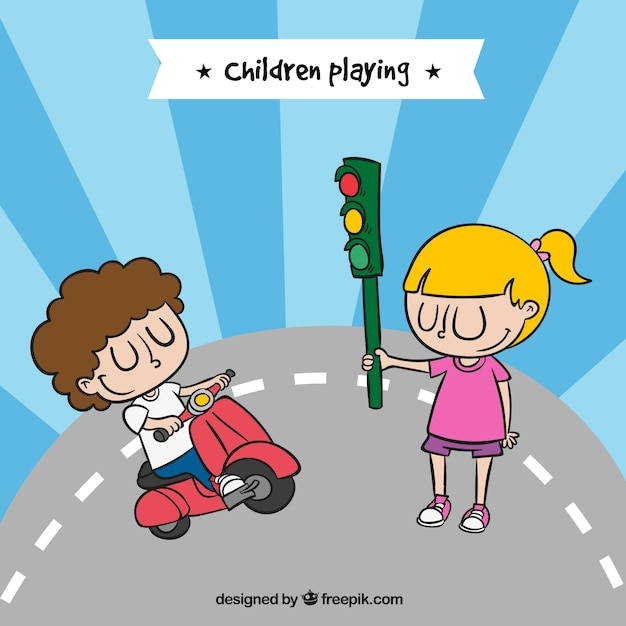 Happy children playing with a motorcycle and a\ traffic light