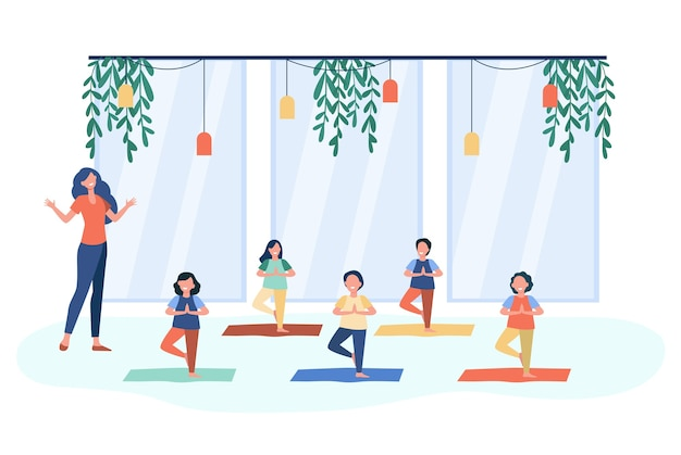 Happy children practicing yoga in class with teacher, standing on mat in tree pose and smiling. vector illustration for kids in fitness club, activity, active lifestyle concept Free Vector