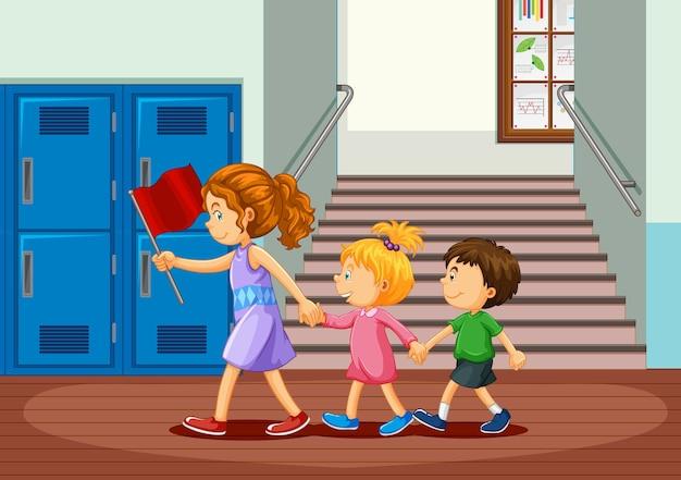 Happy children at school hallway Premium Vector