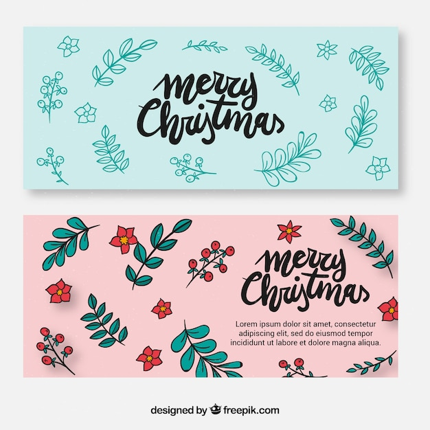 Happy christmas banners with flowers and hand drawn leaves