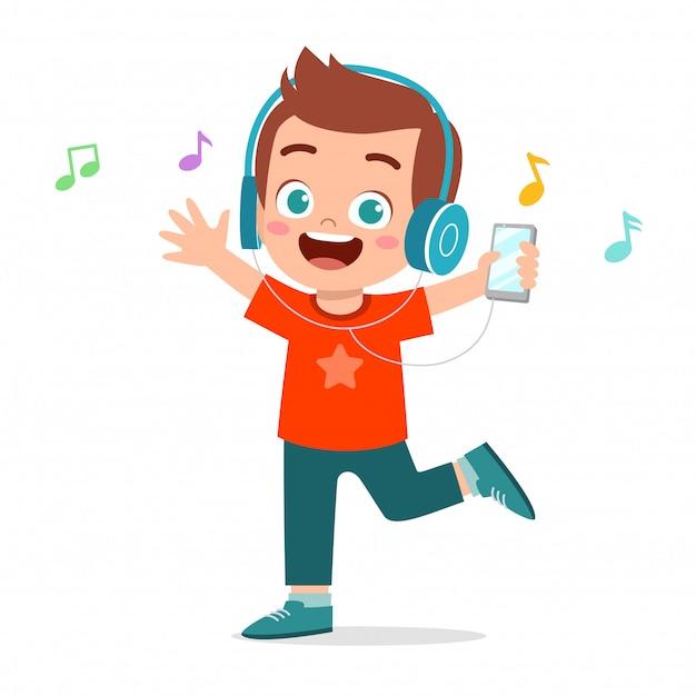Happy cute kid boy listen to music Premium Vector