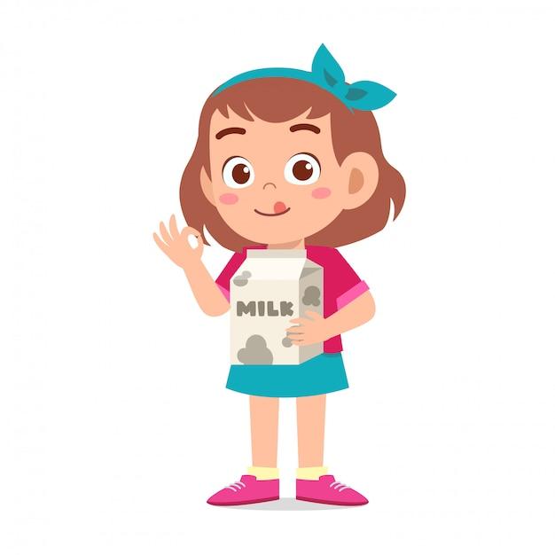 Happy cute kid girl holding milk box Premium Vector