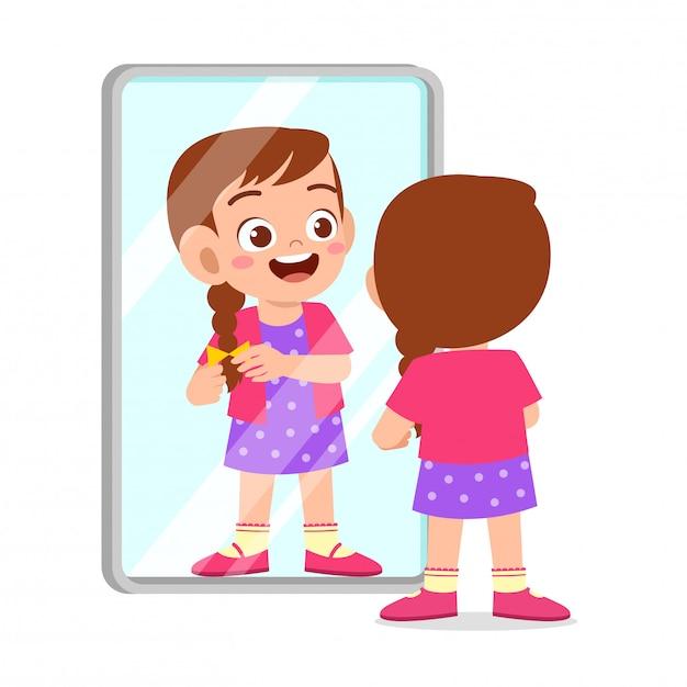 Happy cute kid girl use mirror in morning Premium Vector