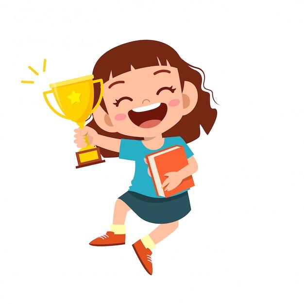 Happy cute kid girl win game gold trophy Premium Vector