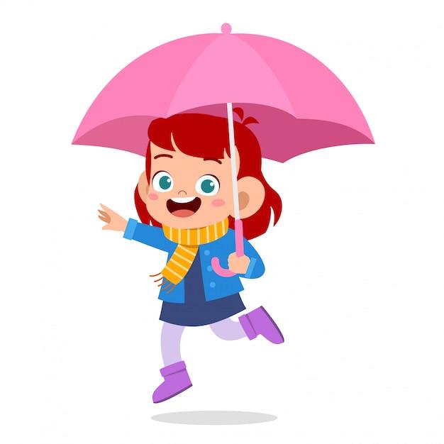 Happy cute kid use umbrella rain day Premium Vector