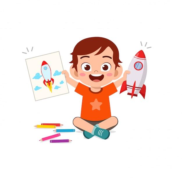 幸せなかわいい子供男の子と女の子を紙にクレヨンで描く Premiumベクター