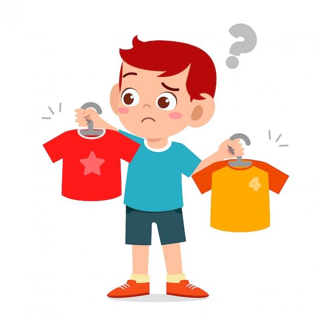 Premium Vector | Happy cute little kid boy choose clothes