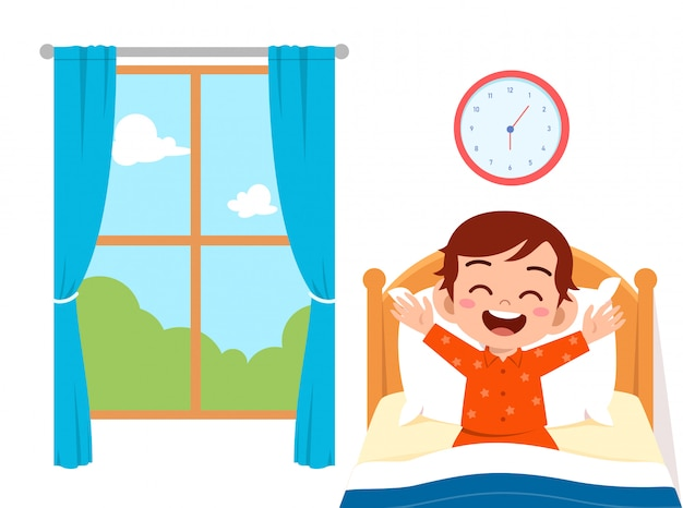 Happy cute little kid boy wake up in the morning Premium Vector
