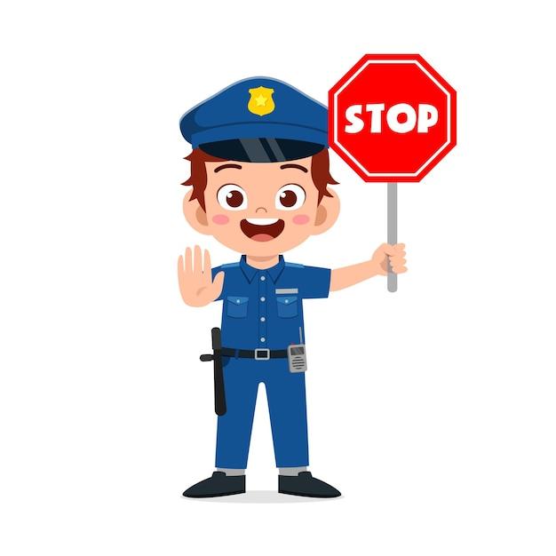 경찰 제복을 입고 정지 신호를 들고 행복 귀여운 꼬마 소년 프리미엄 벡터