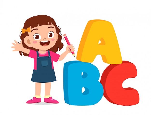 Happy cute little kid boy with alphabet Premium Vector