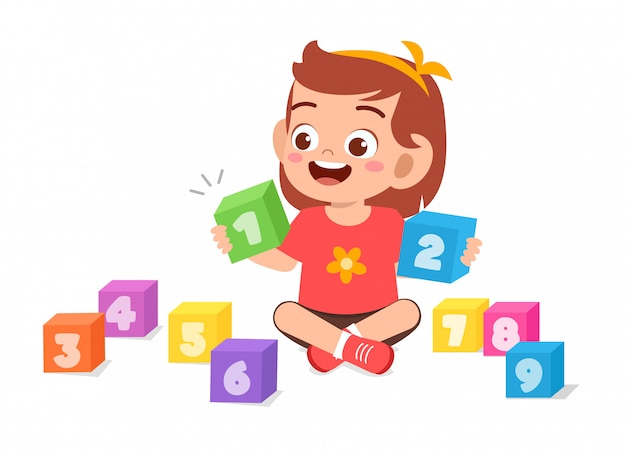 Happy cute little kid girl play with block number Premium Vector