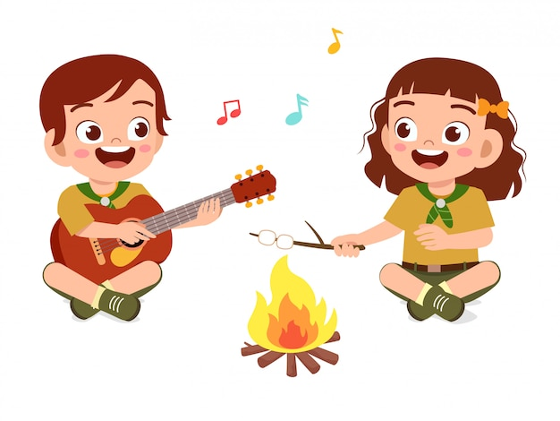 Happy cute little scout boy and girl sing on campfire Premium Vector