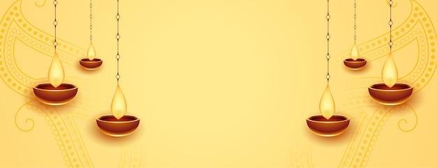 Счастливый дивали золотой баннер с висящим дия Бесплатные векторы
