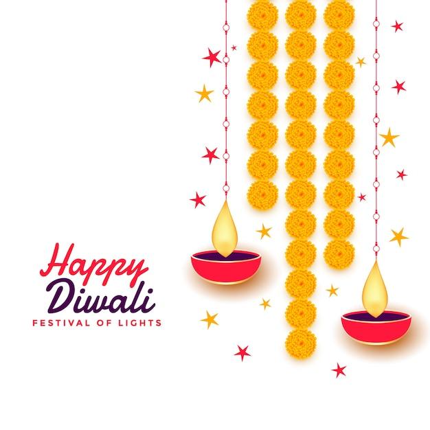 Happy diwali greeting card with diya and marigold flower Free Vector