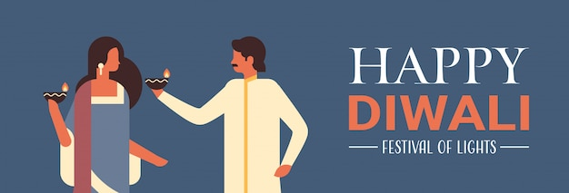 Happy diwali indian couple holding oil lamp candle celebration banner Premium Vector