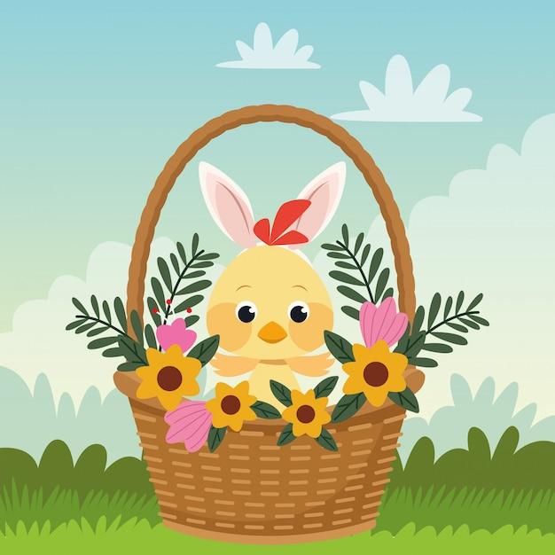 かごの中の小さなひよこと耳のウサギとの幸せなイースターカード Premiumベクター