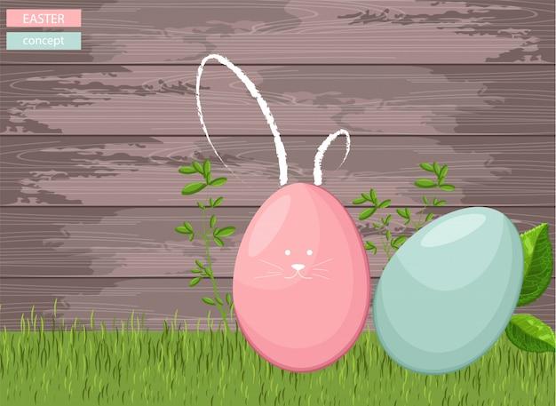 木製の背景を持つ草に幸せなイースターカラフルな卵 無料ベクター
