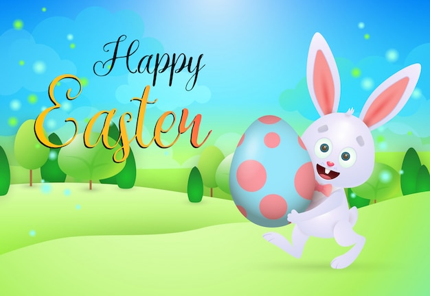 Happy easter lettering with bunny carrying egg on meadow Free Vector
