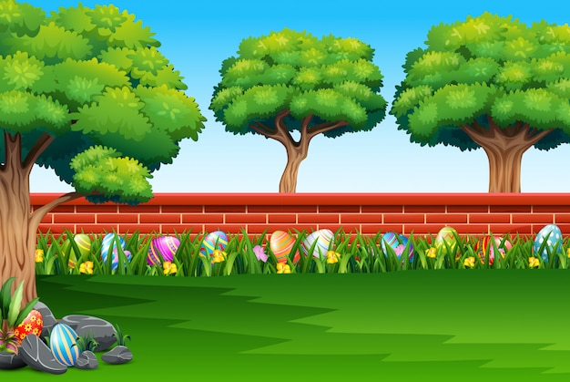 Happy easter on the nature with a brick fence background Premium Vector