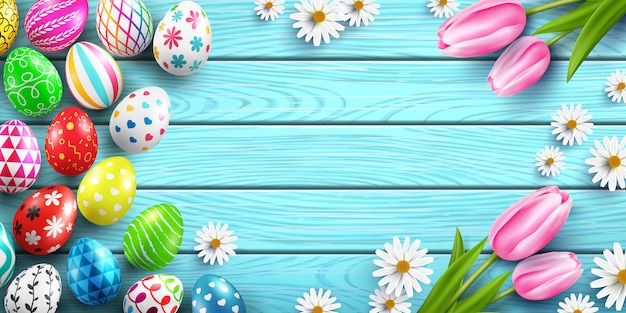 Happy easter  template with colorful easter eggs and flower on wood table Premium Vector