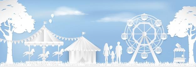 Happy family in amusement park