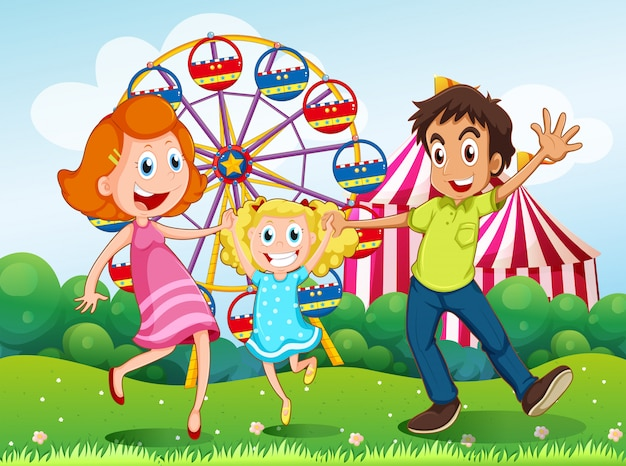 A happy family at the carnival in the hilltop Free Vector