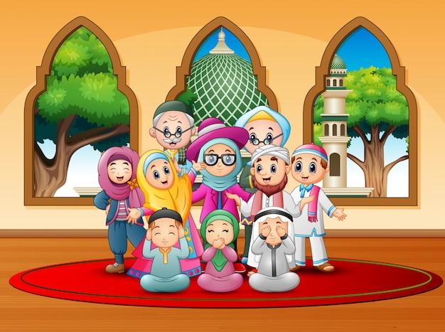 Happy family celebrate for eid mubarak at mosque Premium Vector