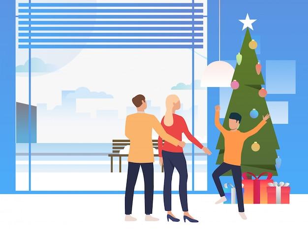 Happy family celebrating christmas Free Vector