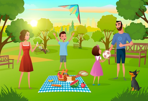 Happy family enjoying picnic Premium Vector